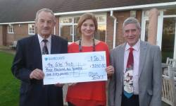 Brian and Terry present Cathryn Worth with the cheque.