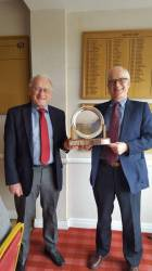 Peter Siddall receives the Bill Danter Salver from Neil Brenton as the winner, on 39 points.
