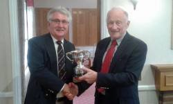 David Johns receives the Grandfathers Cup from organizer Neil Brenton, with a score of 39 points.